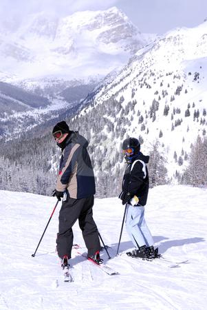 Downhill skiing stock photo, Family downhill ski vacation in snowy Canadian Rockies by Elena Elisseeva
