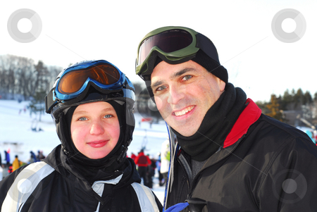 Family ski stock photo, Portrait of a happy family on downhill ski resort by Elena Elisseeva
