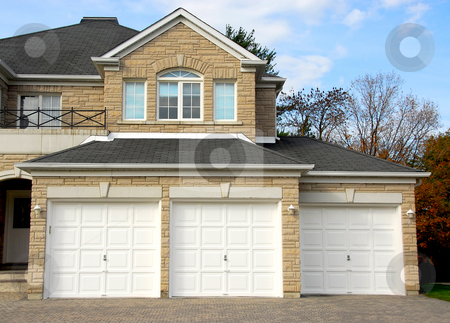 House stock photo, New detached single family luxury home with stone facade and tripple garage by Elena Elisseeva