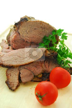 Beef roast stock photo, Beef roast cut on a wooden cutting board by Elena Elisseeva