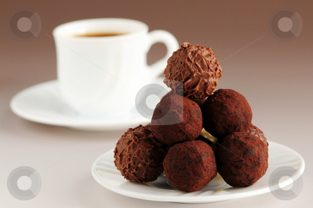 Chocolate truffles and coffee stock photo, Gourmet chocolate truffles on a plate with a cup of coffee by Elena Elisseeva