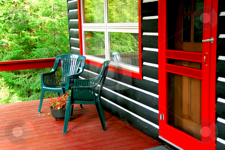 Log cabin deck stock photo, Deck of a log cottage in pine forest by Elena Elisseeva
