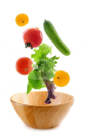 Fresh vegetables falling stock photo, Assorted fresh vegetables falling into a wooden salad bowl isolated on white background by Elena Elisseeva