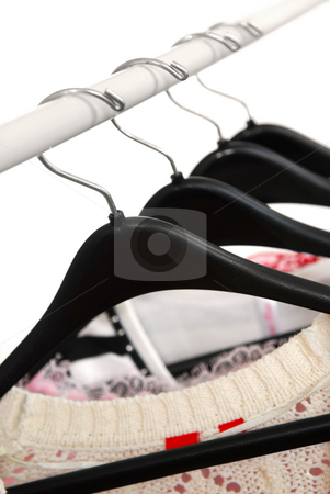 Clothes stock photo, Women's clothing on a rack on black hangers by Elena Elisseeva