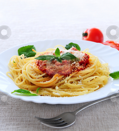 Plate of pasta stock photo, Big plate of pasta with tomato sauce and parmesan by Elena Elisseeva