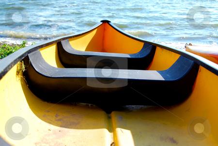 Yellow boat stock photo, Yellow canoe on lake shore by Elena Elisseeva