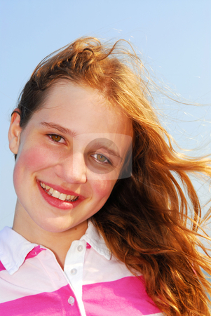 Young girl stock photo, Portrait of a beautiful young girl on a breezy day outside by Elena Elisseeva