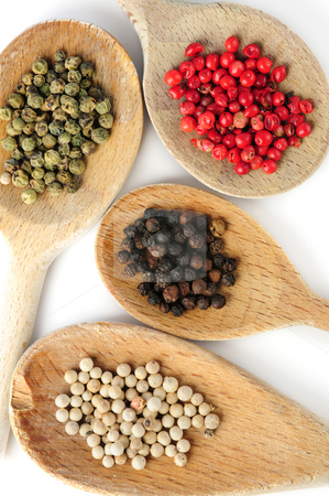Assorted peppercorns stock photo, Four kinds of peppercorns in wooden cooking spoons by Elena Elisseeva