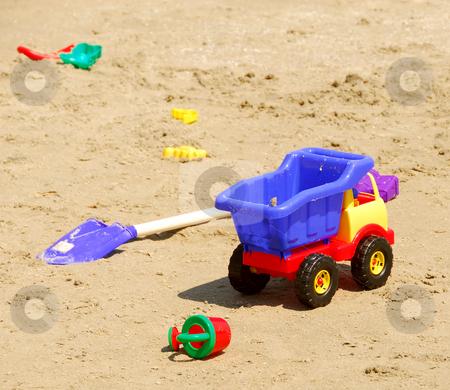 Beach toys stock photo, Children's sand plastic toys on a beach by Elena Elisseeva