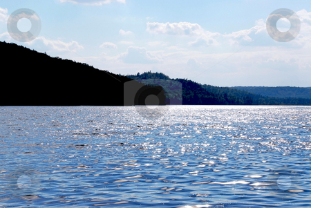 Sparkling lake stock photo, Sparkiling blue lake in Algonquin provincial park, Canada by Elena Elisseeva