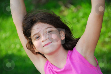 Girl stock photo, Portrait of a young girl playing on a playground at summertime by Elena Elisseeva