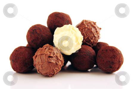Chocolate truffles stock photo, Pile of assorted chocolate truffles isolated on white background by Elena Elisseeva