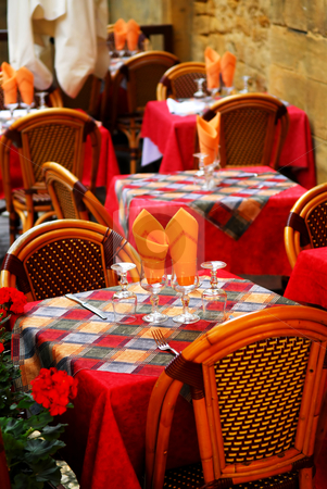 Restaurant patio stock photo, Set tables with tablecloth and glasses on restaurant outdoor patio by Elena Elisseeva