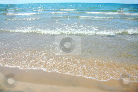 Beach wave sand stock photo, Waves on sandy beach by Elena Elisseeva