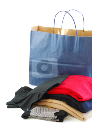 Clothes folded stock photo, Folded sweaters with a paper shopping bag on white background by Elena Elisseeva