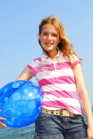 Young girl with beach ball stock photo, Portrait of a young beautiful girl on sea shore with beach ball by Elena Elisseeva