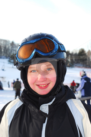 Girl ski stock photo, Portrait of a happy girl on downhill ski resort by Elena Elisseeva