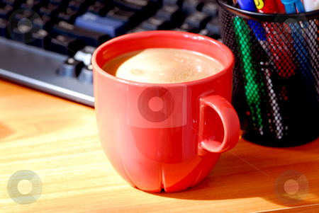 Coffee keyboard  stock photo, Coffee and keyboard on a desk by Elena Elisseeva