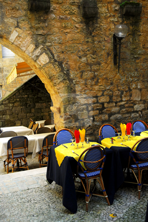Medieval Sarlat, France stock photo, Restaurant patio among medieval walls in Sarlat, Dordogne region, France by Elena Elisseeva