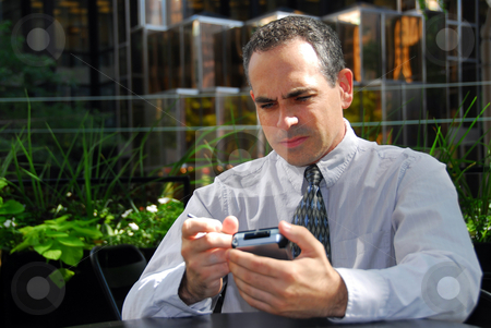 Businessman pda stock photo, Businessman holding pda looking stressed by Elena Elisseeva