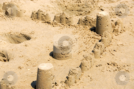 Sand castle stock photo, Sand castle with towers and walls on a beach by Elena Elisseeva
