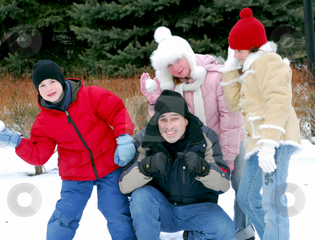 Family portrait stock photo, Portrait of a happy family playing in winter park by Elena Elisseeva