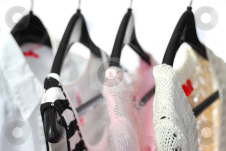 Clothes stock photo, Women's clothing on a rack, white background by Elena Elisseeva
