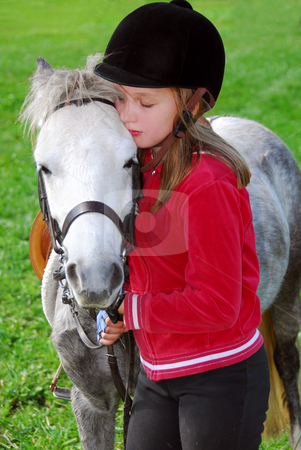 Girl and pony stock photo, Young girl with a white pony at countryside by Elena Elisseeva