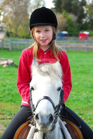 Riding stock photo, Young girl riding a white pony at countryside by Elena Elisseeva