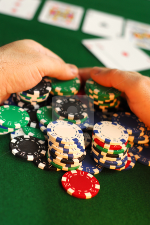 Big win stock photo, Poker player raking a big pile of chips by Elena Elisseeva