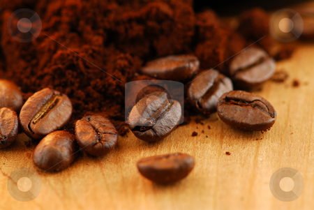 Coffee beans and ground coffee stock photo, Macro image of coffee beans and ground coffee by Elena Elisseeva