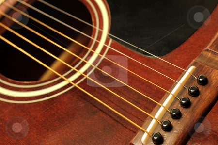 Guitar close up stock photo, Acoustic guitar bridge and strings close up by Elena Elisseeva