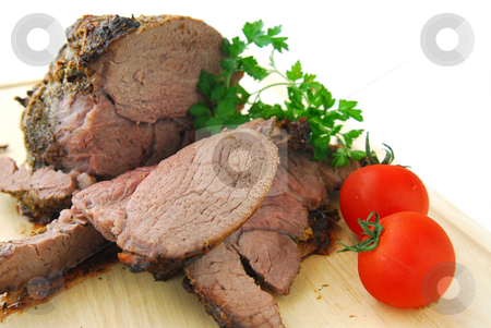 Beef roast stock photo, Beef roast cut on a cutting board by Elena Elisseeva
