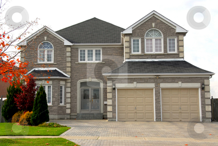 House stock photo, New detached single family luxury home with stone facade by Elena Elisseeva