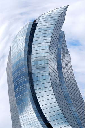 Distorted skyscraper stock photo, Distorted futuristic corporate building with glass walls reflecting clouds by Elena Elisseeva