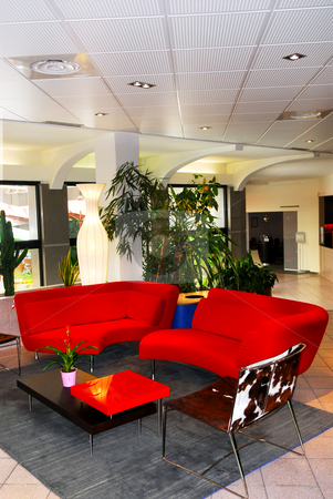 Hotel lobby interior stock photo, Interior of a modern european hotel lobby with red sofas by Elena Elisseeva