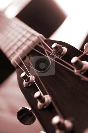 Guitar close up stock photo, Headstock and tuners of an acoustic guitar close up by Elena Elisseeva