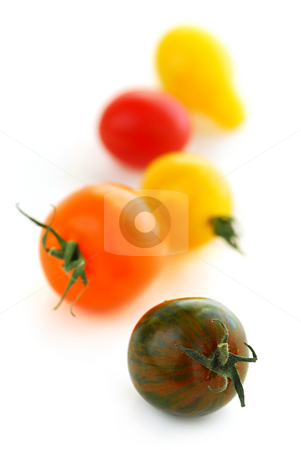 Cherry tomatoes stock photo, Multicolored cherry tomatoes isolated on white background by Elena Elisseeva