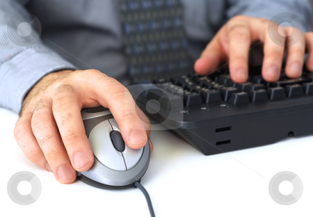 Working on computer stock photo, Closeup of man's hands with computer mouse and keyboard by Elena Elisseeva