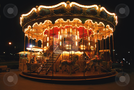 Carousel stock photo, Brightly illuminated traditional carousel in Paris France at night by Elena Elisseeva