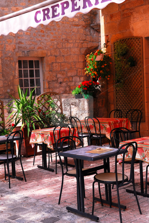 Restaurant patio stock photo, Restaurant patio in medieval town of Sarlat, France by Elena Elisseeva