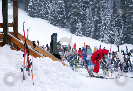 Downhill skiing stock photo, Ski rack near a chalet at downhill ski resort by Elena Elisseeva