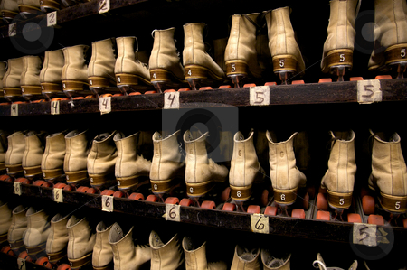 Picking out a pair of roller skates stock photo, The roller skates are all lined up ready to be worn at the roller rink. by Mitch Aunger
