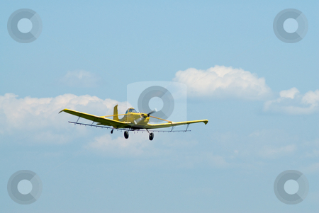 Retirement stock photo, A small plane flying against a blue sky symbolizing retirement by Richard Nelson
