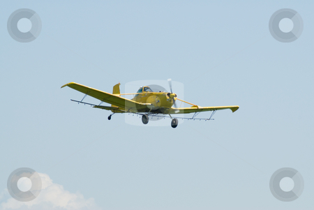 Flight stock photo, A small plane high in the sky in the middle of flight by Richard Nelson