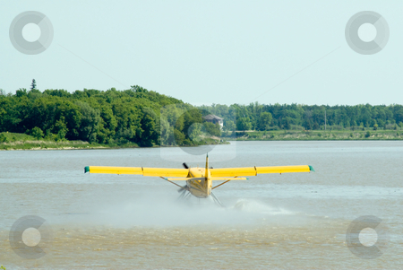 Prepare For Take-off stock photo, A water plane cruising along the river about to take off by Richard Nelson