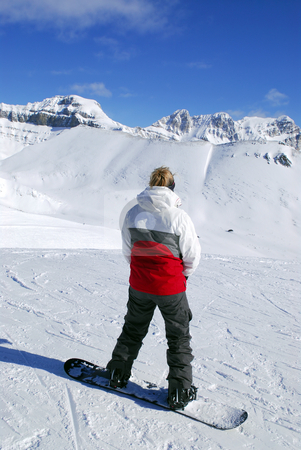 Mountains snowboarding stock photo, Girl on snowboard enjoying scenic view in Canadian Rocky mountains ski resort by Elena Elisseeva