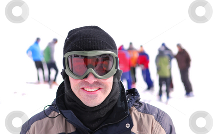 Skier  stock photo, Portrait of a skier with his friends at downhill ski resort by Elena Elisseeva