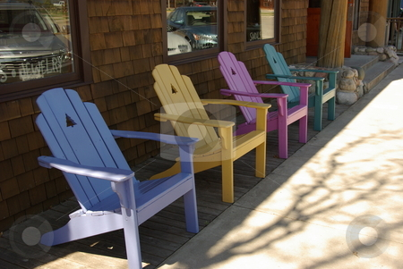 Pastel Adirondack chairs stock photo, Four pastel colored Adirondack chairs in front of a Niisswa, MN storefront are ready for business. by Dennis Thomsen