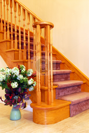 Hallway staricase stock photo, Interior of a house hallway with solid wood staircase by Elena Elisseeva